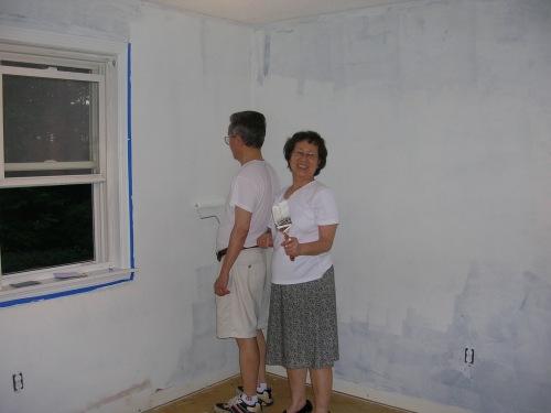 Grandpa and Grandma Chen working on the baby's room